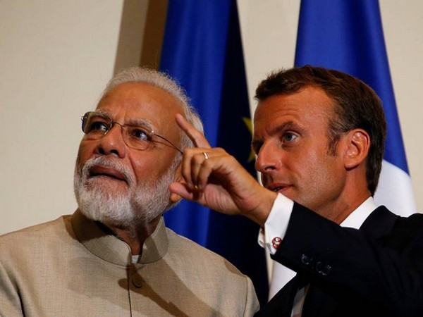 Prime Minister Narendra Modi with French President Emmanuel Macron during a joint interaction in Chantilly on Thursday
