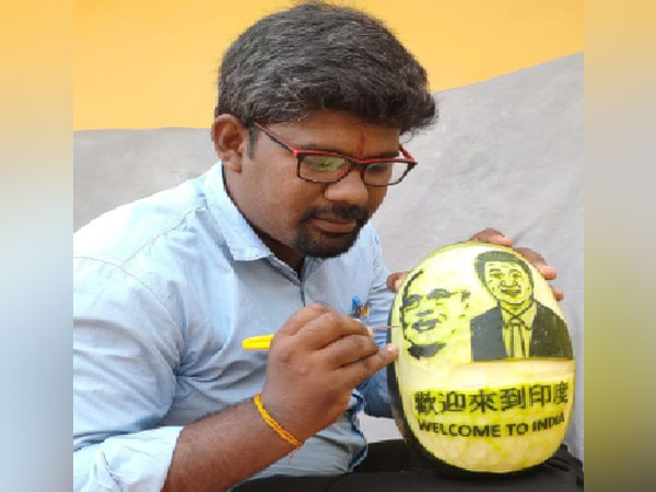 M Elanchezian-the artist who carved images of Prime Minister Narendra Modi and Chinese President Xi Jinping on watermelon.