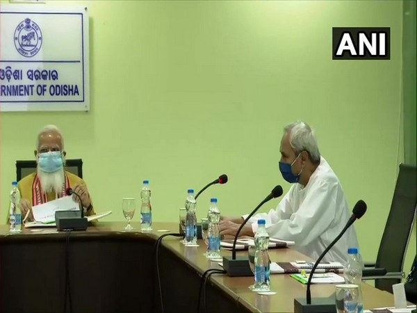 Prime Minister Narendra Modi and Odisha Chief Minister Naveen Patnaik during the review meeting today. (Photo/ ANI)