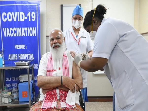 Prime Minister Narendra Modi taking first dose of COVID-19 vaccine. (Photo/ANI)