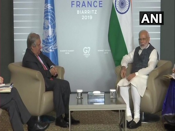 Prime Minister Narendra Modi and UN Secy General Antonio Guterres during their meeting on the sidelines of G-7 summit. Photo/ANI