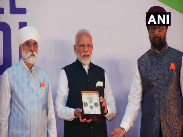 PM Modi releases commemorative coin marking the 550th birth anniversary of Guru Nanak