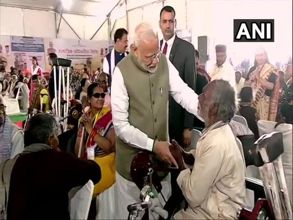 Prime Minister Narendra Modi at a distributive camp in Prayagraj on Saturday