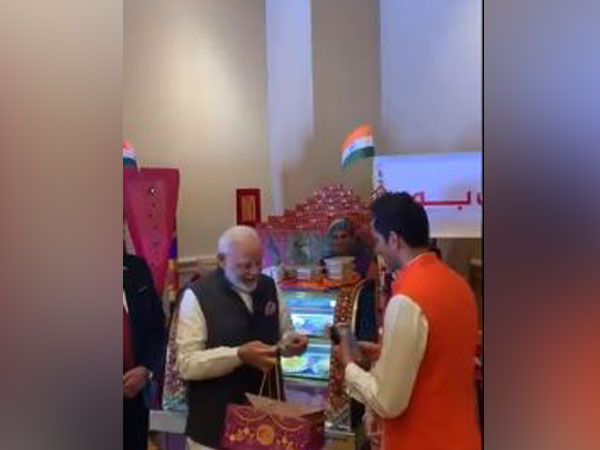 Prime Minister Narendra Modi making transaction using RuPay card in the UAE on Saturday.