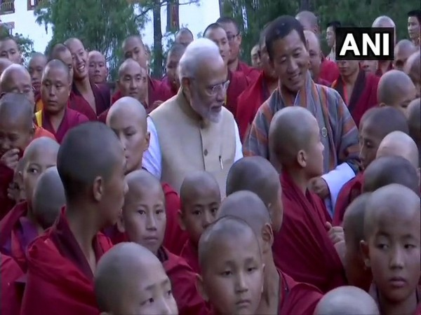 Prime Minister Narendra Modi interacting with a group of monks at Simtokha Dzong on Saturday