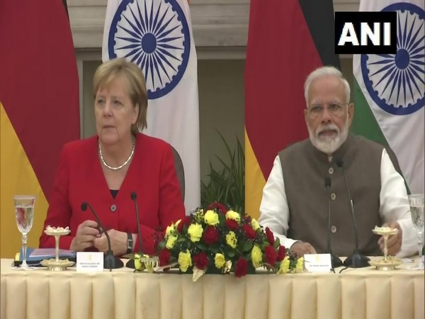 German Chancellor Angela Merkel and Prime Minister Narendra Modi in New Delhi on Friday. Photo/ANI