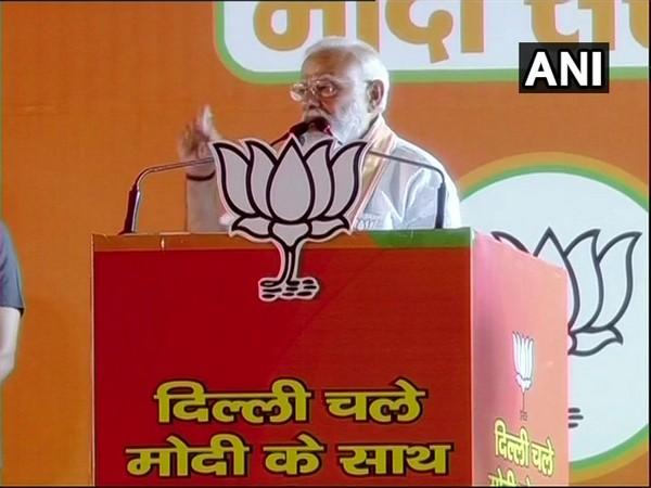 Prime Minister Narendra Modi addressing a public rally in Delhi on Wednesday.