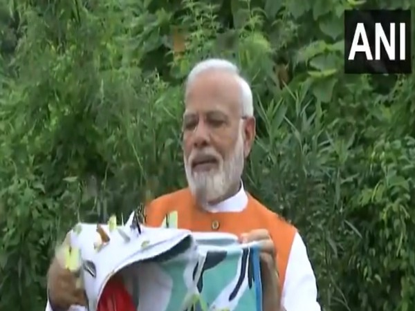 Prime Minister Narendra Modi release basket full of fluttering butterflies at the Butterfly Garden in Kevadia, Gujarat on Tuesday.