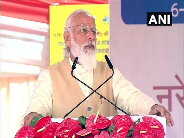 Prime Minister Narendra Modi addressing an event in Varanasi on Monday. (Photo/ANI)