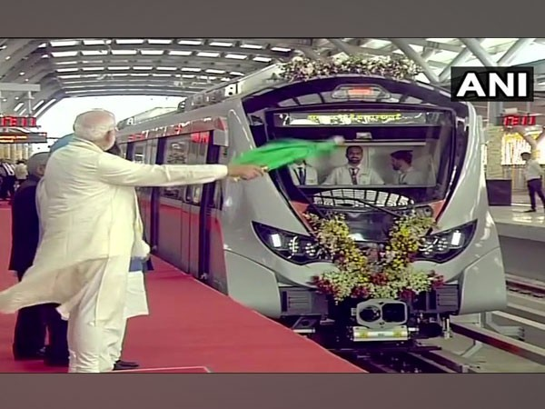Visual of PM Modi flagging off the metro in Ahemdabad on Monday.