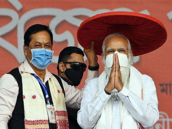 Assam Chief Minister Sarbananda Sonowal (left) and Prime Minister Narendra Modi (right)
