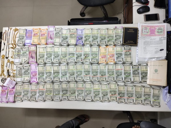 The gold and cash seized by Telangana Police on Wednesday. (Photo/ANI)