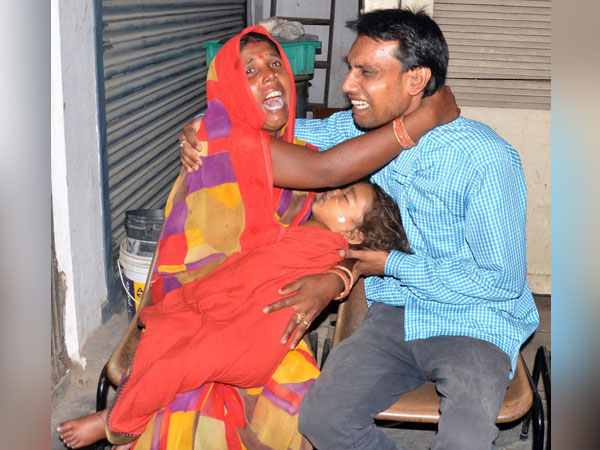 Family members mourn on the loss of their child due to Acute Encephalitis Syndrome (AES) at a hospital in Muzaffarpur. (ANI Photo)