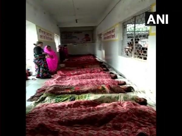 Women lying on the floor of Gyaraspur primary health centre in Vidisha, Madhya Pradesh.