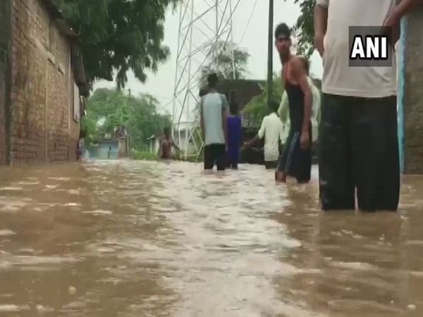 Water-logged locals of the village. (Photo/ANI)