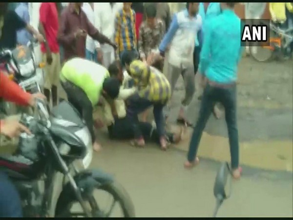 Visuals of the man being beaten up in public on Wednesday in Dewas. Photo/ANI