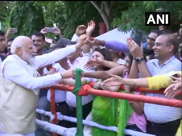 Prime Minister Narendra Modi greeting the Indian diaspora at India House in Colombo on Sunday (Photo/ANI)