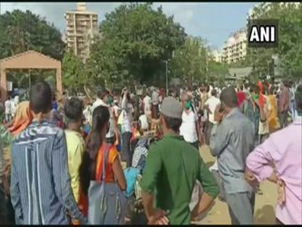 Large number of migrant labourers  gathered at the grounds in Kandivali's Mahavir Nagar on Thursday [Photo/ANI]