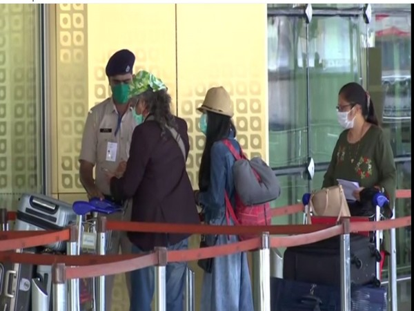 Passengers wearing mask checking into the Mumbai Airport on Wednesday. Photo/ANI