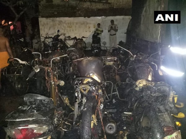 Motorcycles and four-wheelers gutted in Fire in Vijay Nagar area here on Thursday. Photo/ANI