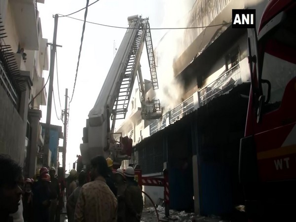 Fire fighters trying to douse the fire in a spare factory in Mundka on Thursday.