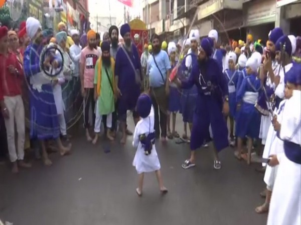 men performing various stunts including children in the procession outside in Amritsar in Punjab on Saturday. Photo/ANI