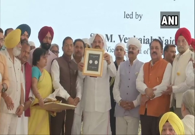 Vice President M Venkaiah Naidu releasing a commemorative coin of Rs 100 and a Postage Stamp at Jallianwala Bagh memorial in Amritsar on Saturday. Photo/ANI