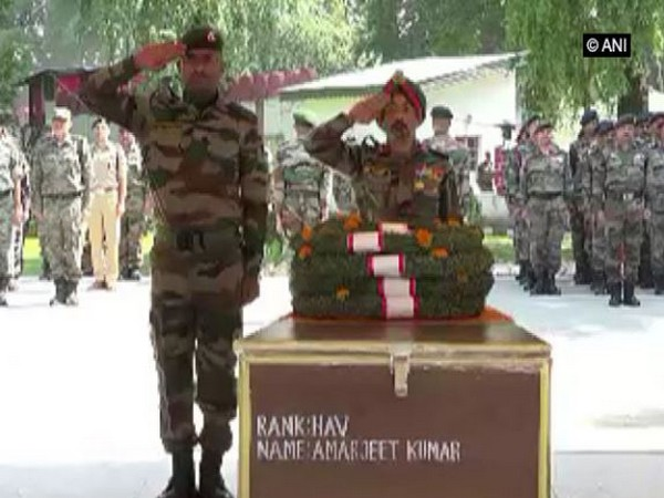 Indian Army paying tribute to martyred jawans- Naik Ajit Kumar Sahoo and Havildar Amarjeet Kumar in Srinagar on June 18 (Photo/ANI)