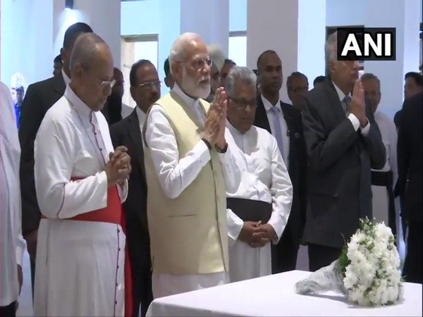 Prime Minister Narendra Modi paying his respect at the St. Anthony's Church in Kochchikade on Sunday (Photo/ANI)
