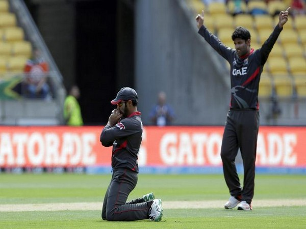Mohammad Naveed celebrating after getting a wicket