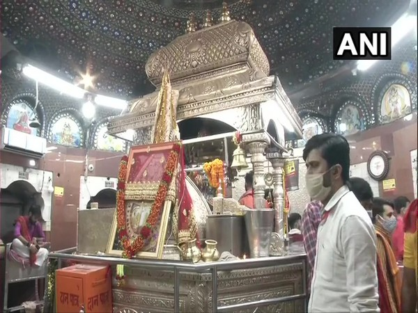 Devotees queue up outside Delhi's Kalka Ji Temple to offer their prayers on the first day of Navratri. (Photo/ANI)