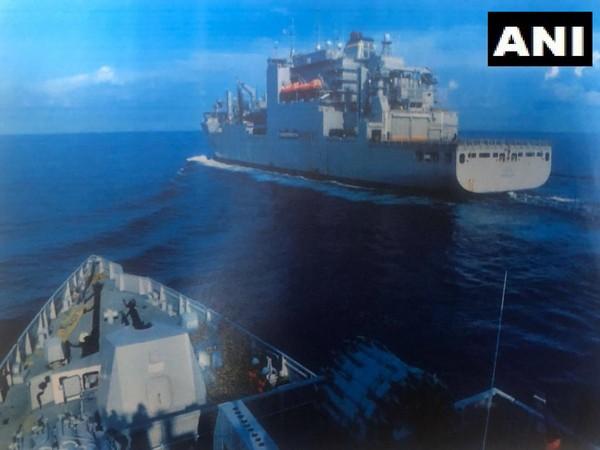 Indian Navy warship taking fuel supplies from US Navy warship near South China Sea.