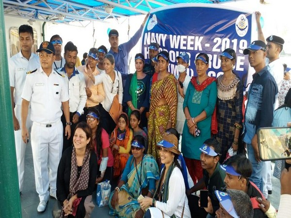The children from TMC institute with officials of the Indian Navy. Photo/PIB