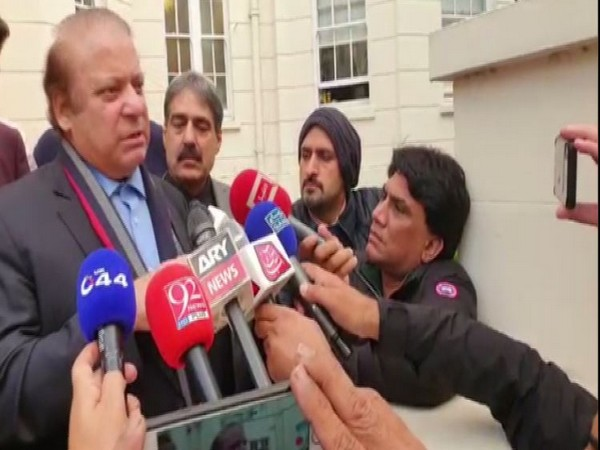 Former Pakistan Prmime Minister Nawaz Sharif speaking to reporters in London