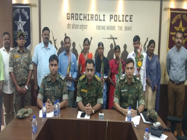 The surrendered naxals with the Gadchiroli police team on Tuesday (Photo/ANI)