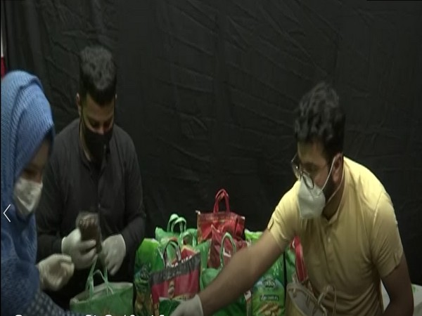 Youngsters packing food kit to distribute among poor in Srinagar. (Photo/ANI)
