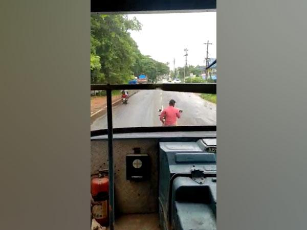 The bike rider blocking the way of KSRTC bus.