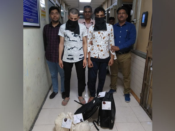 Two arrested drug smugglers in the custody of NCB officials in New Delhi on Monday.