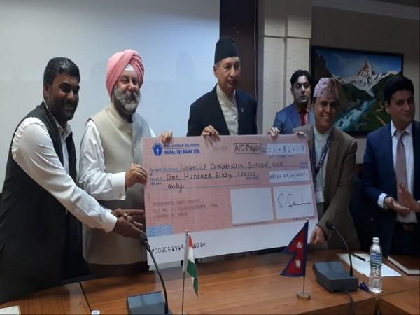 Ambassador of India to Nepal, Manjeev Singh Puri, handing over the cheque for housing reconstruction in areas devastated by the 2015 earthquake