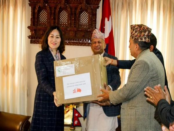 Nepali Foreign Affairs Minister Pradeep Kumar Gyawali donates masks to Chinese Ambassador Hou Yanqi in Kathmandu