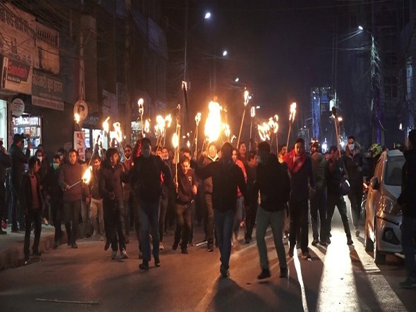 Nepal: Rival faction of ruling NCP hold torch light protest against the Parliament dissolution