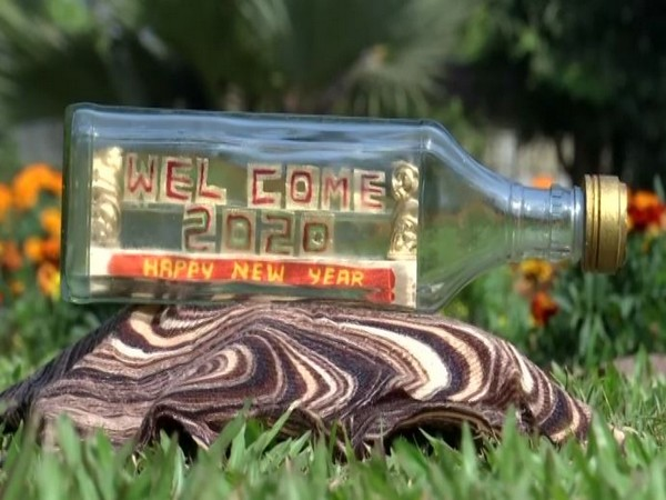 The miniature art 'Welcome 2020' inside the glass bottle. Photo/ANI