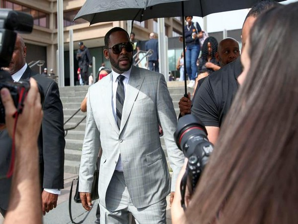 R. Kelly leaves a court in Chicago after pleading not guilty of criminal sexual abuse, in June