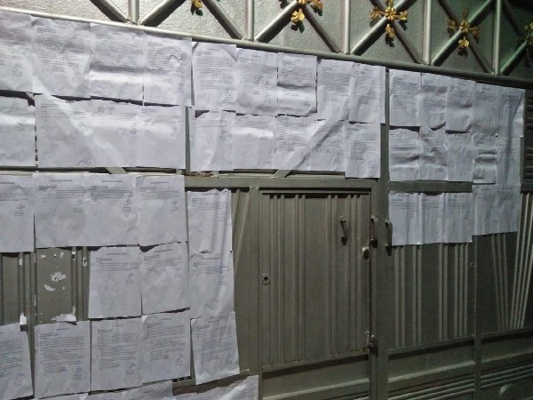Court notices pasted outside SP MP Azam Khan's residence in Rampur, Uttar Pradesh on Monday.