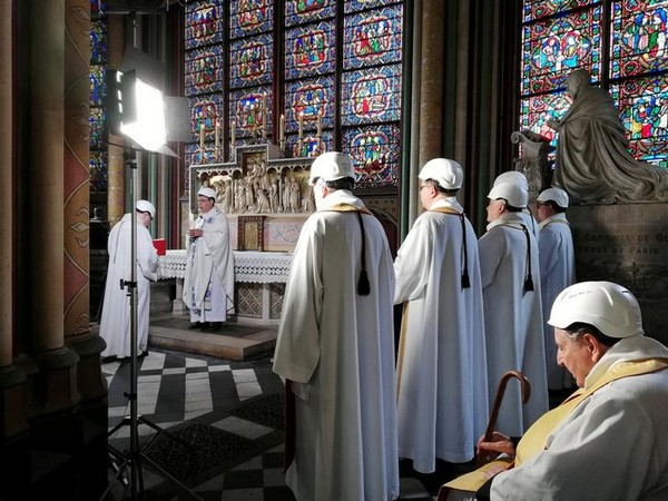The Archbishop of Paris on Saturday leads the first Mass at Notre-Dame two months after a devastating fire at the cathedral in Paris.