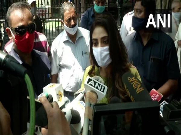 TMC MP Nusrat Jahan speaking to reporters in Kolkata on Wednesday.
