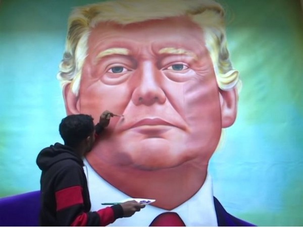 Artist Jagjot Singh painting a picture of USA President Donald J Trump on a canvas.