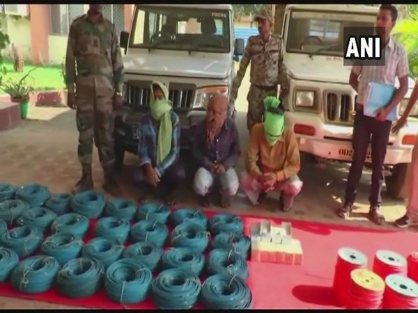Cops with arrested Naxals on Monday. Photo/ANI
