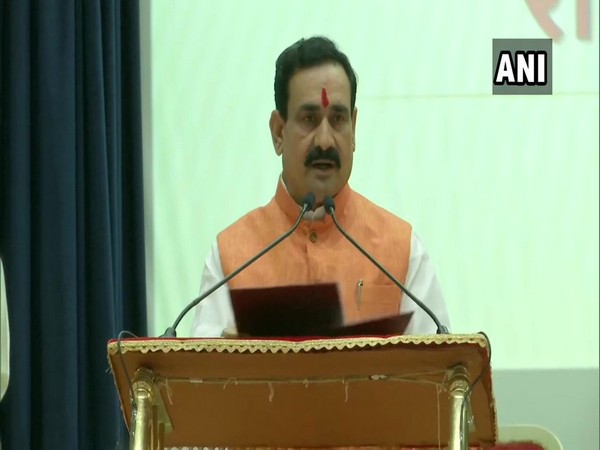 Narottam Mishra taking oath as minister in Bhopal on Tuesday.