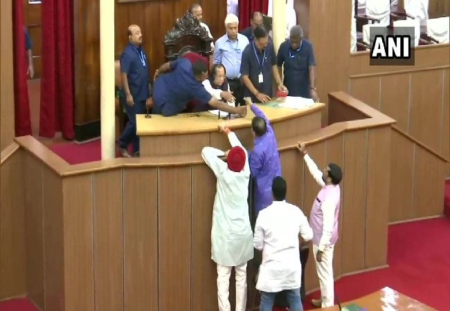 Congress MLAs staging protest in the well of the House at Odisha assembly in Bhubaneswar on Thursday.